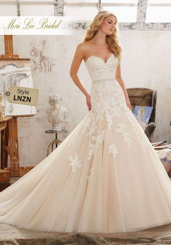 Dress style LNZN Mackenzie Wedding Dress Colors Available: White, Ivory, Ivory/Caramel. Shown in Ivory/Caramel.