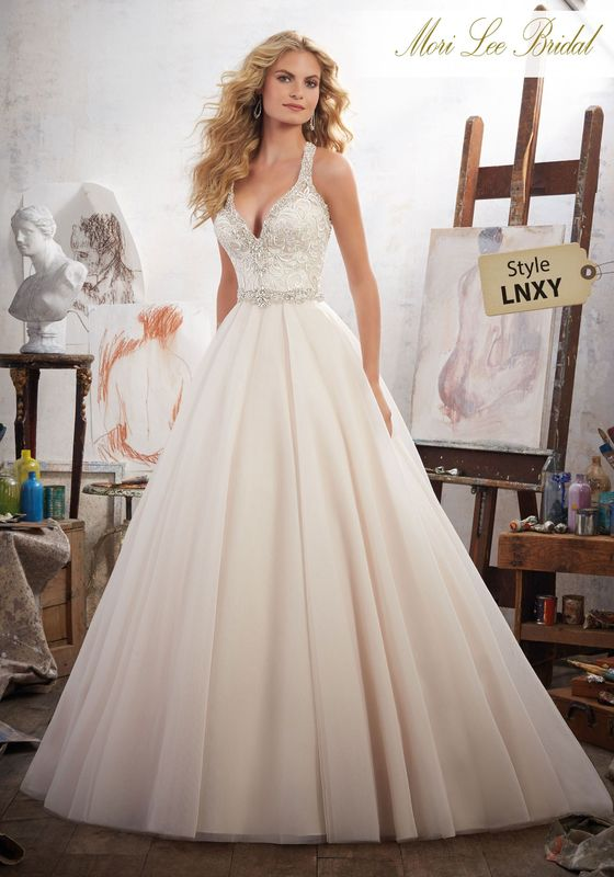 Dress style LNXY Margarita Wedding Dress Colors: White, Ivory, Ivory/Champagne. Shown in Ivory/Champagne.
