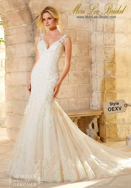 Dress Style OEXV Lace And Embroidered Appliques On Net With a Scalloped Hemline  With a deep V neckline and feminine fit and flare silhouette, this wedding gown seamlessly combines trend and tradition. Available in Three Lengths: 55