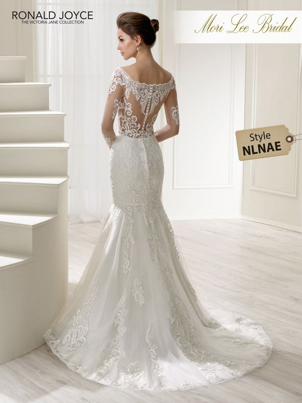 Style NLNAE LAMBERTA A TULLE FISHTAIL GOWN WITH LACE MOTIFS, BATEAU NECKLINE, ILLUSION BACK AND LONG SLEEVES. PICTURED IN IVORY. AVAILABLE IN 3 LENGTHS: 55', 58' AND 61'   COLOURS WHITE, IVORY