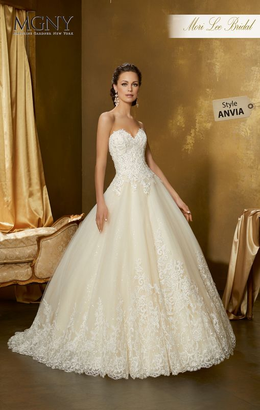 Style ANVIA Orida  Crystal beaded alençon lace appliqués on a tulle ball gown with wide hemlace over sequined tulle