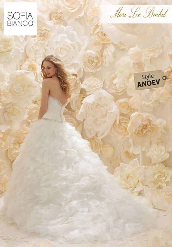 Style ANOEV A LAYERED ORGANZA SWEETHEART BODICE WITH DIAMANTE EDGING AND WAISTBAND ON A RUFFLED ORGANZA BALL SKIRT   AVAILABLE IN 3 LENGTHS: 55', 58' AND 61'     COLOURS WHITE / SILVER OR IVORY / SILVER