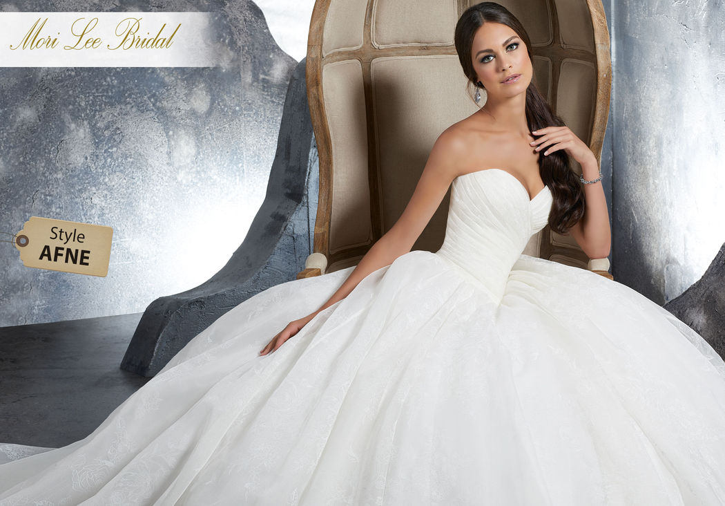 Style AFNE Kalinda Wedding Dress  Draped Floral Printed Organza Bridal Ball Gown Featuring a Ruched Basque Waist Sweetheart Bodice. A Zipper Closure Trimmed in Covered Buttons Completes the Look. Colors Available: White, Ivory, Ivory/Floral