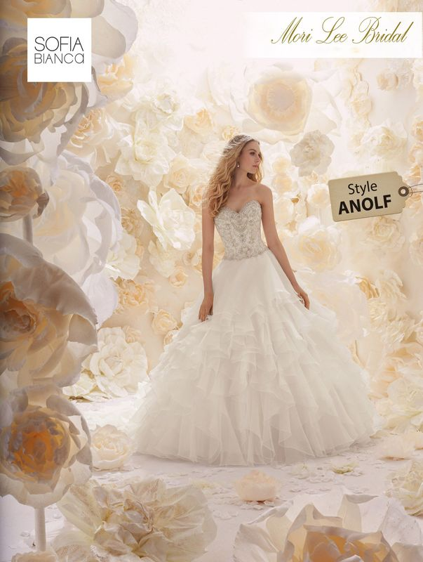 Style ANOLF A STRAPLESS SWEETHEART DIAMANTE AND CRYSTAL BODICE EMBROIDERED ON A LAYERED ORGANZA SKIRT   AVAILABLE IN 3 LENGTHS: 55', 58' AND 61'     COLOURS WHITE / SILVER, IVORY / SILVER