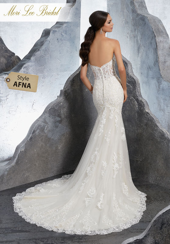 Style AFNA Kirstie Wedding Dress  Frosted, Embroidered Medallions and Appliqués Accent This Net Fit and Flare Wedding Dress. A Deep Sweetheart Neckline and Wide Scalloped Hemline Complete the Look. Available in Three Lengths: 55″, 58″, 61″. Colors Available: White, Ivory, Ivory/Champagne