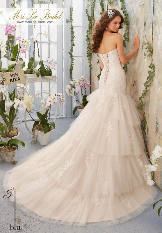 "Dress Style AIZA Soft Net Overlays Alencon Lace Appliques Onto The Tiered Gown  Available in Three Lengths: 55"", 58"", 61"". Colors available: White, Ivory, Ivory/Cameo."