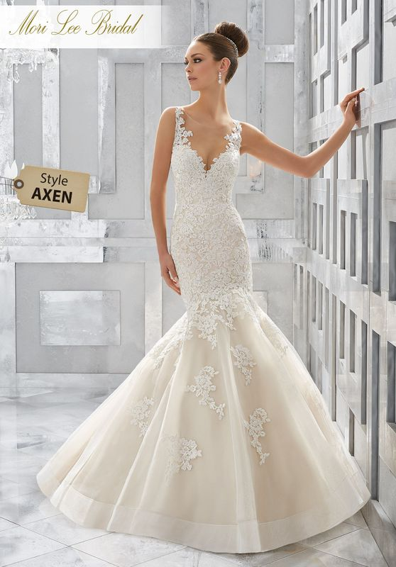 Style AXEN Meryl Wedding Dress  Romantic Frosted Alençon Lace Appliqués Adorn This Classic Fit and Flare Bridal Beauty. Tulle Over Sparkle Net Adds Dimension to the Skirt Finished in Horsehair Trim. Available in Three Lengths: 55″, 58″, 61″. Colors Availble: White, Ivory, Ivory/Light Gold.