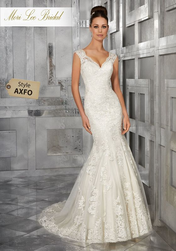 Style AXFO Monet Wedding Dress  Classic and Elegant, This Soft Net Fit and Flare Wedding Dress Features Frosted, Embroidered Appliqués and Scalloped Hemline. An Intricately Embroidered Illusion Back Completes the Look. Shown with Detachable Tulle Train, Sold Separately as Style NXOEO. Available in Three Lengths: 55″, 58″, 61″. Colors Available: White, Ivory, Ivory/Light Gold.