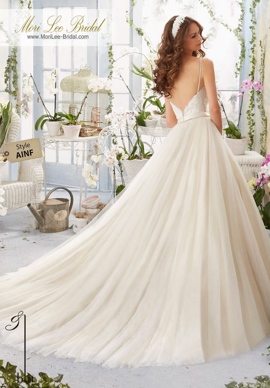 Dress Style AINF Alencon Lace Bodice With Satin Shoulder http://asset3.zankyou.com/images/wervice-card/b29/e16b/600/400/w/12835/-/1444332968.jpgStraps Onto a Soft Net Ball Gown  Removable Beaded Satin Belt. Colors available: White, Ivory, Ivory/Light Gold.