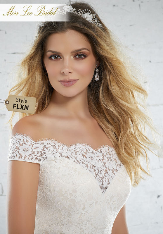 Style FLXN Kolette Wedding Dress  Classic Soft Ballgown Featuring a Vintage Rose Lace Bodice and Flowy English Net Skirt. A Scalloped Off-the-Shoulder Neckling and Covered Buttons Complete the Look. Colors Available: White, Ivory, Ivory/Light Gold