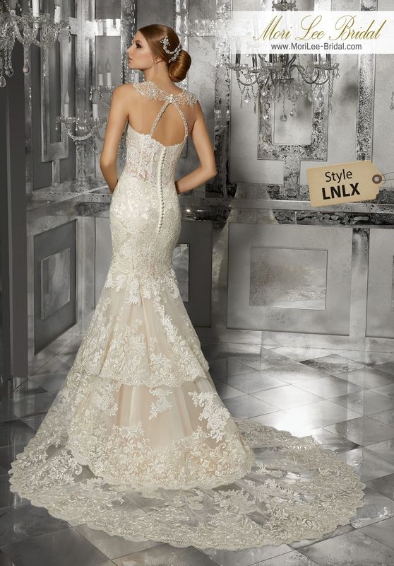 Style LNLX Martella Wedding Dress  This Slim, Fit and Flare Wedding Dress Features Frosted, Embroidered Appliqués with Wide Scalloped Hemline and Sheer Boned Bodice. Matching Satin Bodice Lining Included. Removable Beaded and Embroidered Shoulder Coverlet, Also Sold Separately as Style NXOEF, Completes the Look. Available in Three Lengths: 55″, 58″, 61″. Colors Available: White, Ivory, Ivory/Light Gold.