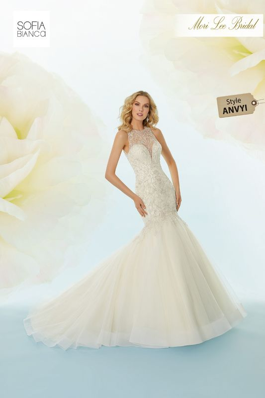Style ANVYI Saoirse  Intricately beaded embroidery on a horsehair edged, tulle mermaid