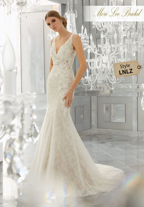 Style LNLZ Mysteria Wedding Dress  Layers of Net over Chantily Lace and Sequined Tulle Create This Beautifully Intricate Wedding Gown. Crystal Beaded, Embroidered Appliqués Accent the Sheer Bodice. Matching Satin Bodice Lining Included. A Deep-V Open Back Completes the Look. Colors Available: White, Ivory, Ivory/Nude.