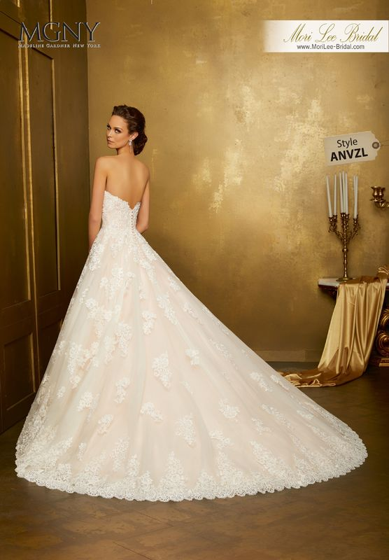 Style ANVZL Oma  Re-embroidered lace appliqués on a tulle ball gown with wide hemlace