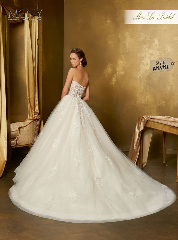 Style ANVNL Olympia  Crystal and diamanté beaded alençon lace appliqués on a boned, corset bodice with tulle ball gown skirt  Matching satin bodice lining included