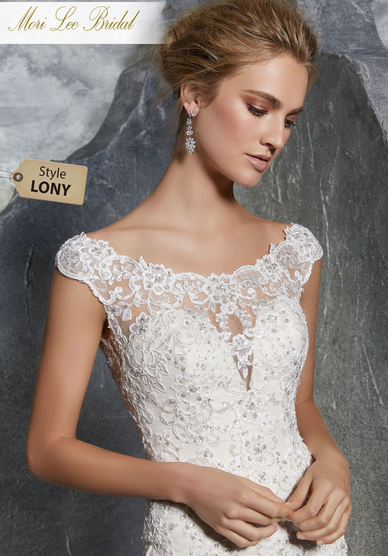 Style LONY  Keely Wedding Dress  Romantic Fit and Flare Bridal Gown with Crystal Beaded Alençon Lace Appliqués on Net. A Wide Scalloped Hemline and Intricately Beaded Illusion Back Trimmed in Covered Buttons Completes the Look. Available in Three Lengths: 55″, 58″, 61″. Colors Available:White, Ivory, Ivory/Champagne