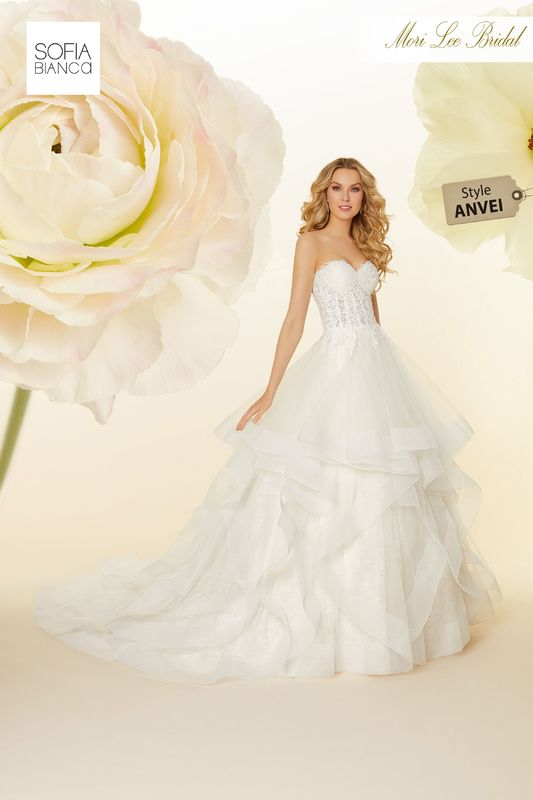 Style ANVEI Serenella  Alençon lace appliqués on boned, corset bodice with horsehair edged, flounces tulle ball gown over chantilly lace  Matching satin bodice lining included