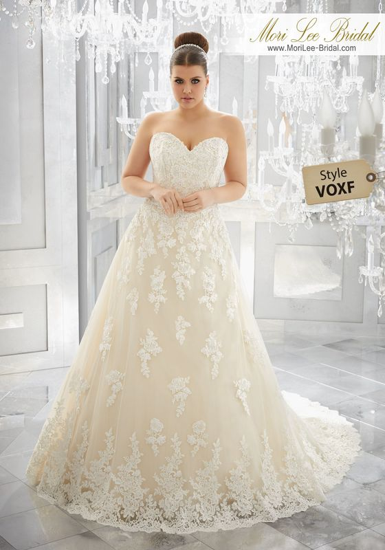 Style VOXF Muriella Wedding Dress  A Classically Elegant Wedding Dress Comes to Life with Diamanté Beaded Alençon Lace Appliqués on This Soft Tulle Ball Gown with Wide Hemlace. Available in Three Lengths: 55″, 58″, 61″. Colors Available: White, Ivory, Ivory/Light Gold.