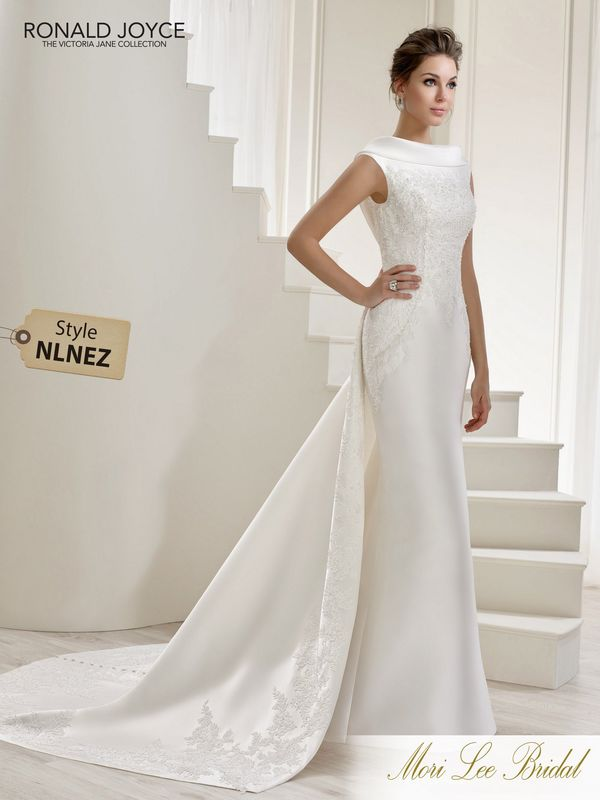 Style NLNEZ LUCIA A MIKADO DRESS WITH A STATEMENT HIGH NECKLINE, LACE APPLIQUES, V-BACK AND A UNIQUE TRAIN. PICTURED IN IVORY.  COLOURS IVORY, WHITE