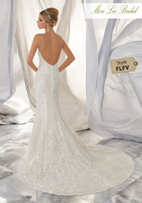 Style FLFV Miri Wedding Dress  Stunning Allover Alençon Lace Takes Center Stage on This Chic Wedding Dress. Delicately Beaded Straps and a Scalloped Hemline Complete the Look. Available in Three Lengths: 55″, 58″, 61″. Colors Available: White, Ivory, Ivory/Champagne .