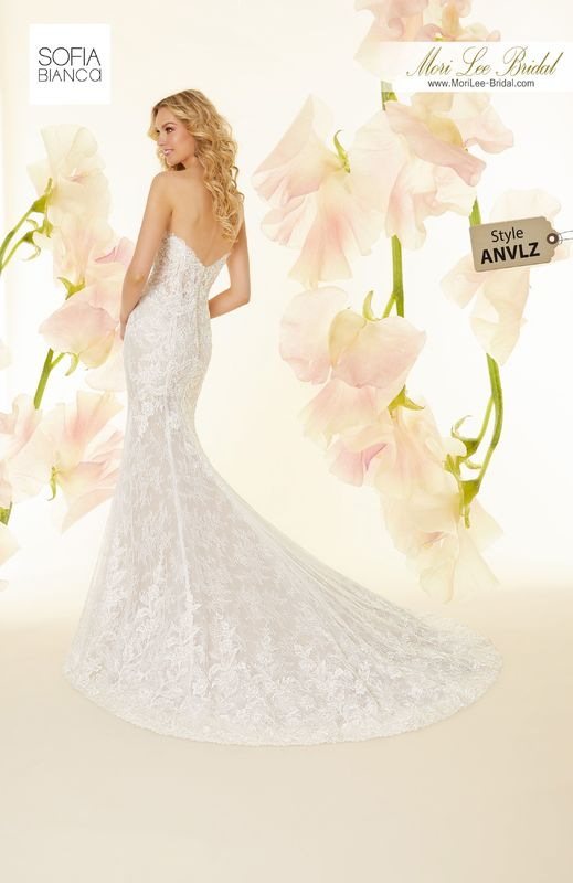 Style ANVLZ Siena  Crystal beaded, alencon lace appliqués on allover chantilly lace with wide hemlace  Detachable lace train  Matching satin bodice lining included