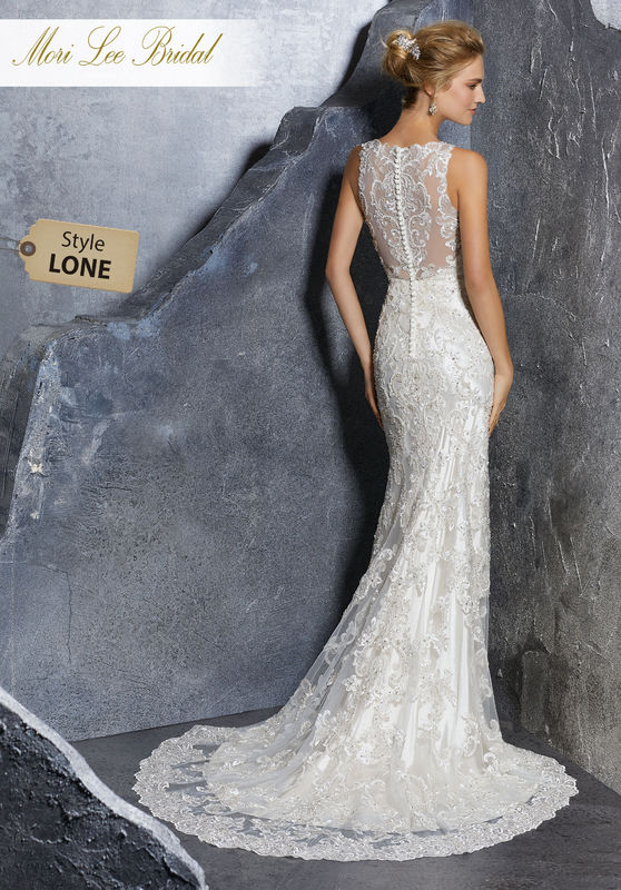 Style LONE  Kadence Wedding Dress  Vintage Inspired Crystal Beaded Gown with Embroidered Appliqués on Net and Scalloped Hemline. An Intricately Beaded Illusion Back Trimmed in Covered Button Details Completes the Look. Available in Three Lengths: 55″, 58″, 61″. Colors Available: White, Ivory, Ivory/Champagne