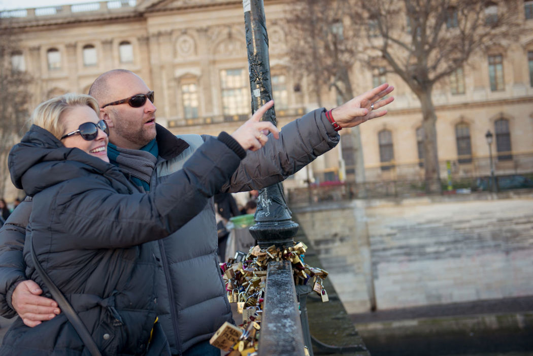 TripShooter - Romantic couple throwing the key of their love padlock in the Seine    Photographer: Jade Maitre