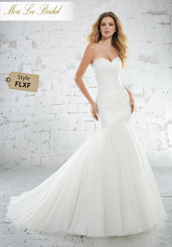 Style FLXF Kenna Wedding Dress  Asymmetrically Draped, Soft Stretch Satin Creates a Figure Flattering Bodice on This Mermaid Silhoutte. A Soft Organza Skirt and Covered Buttons Along the Back Complete the Look. Colors Available: White, Ivory