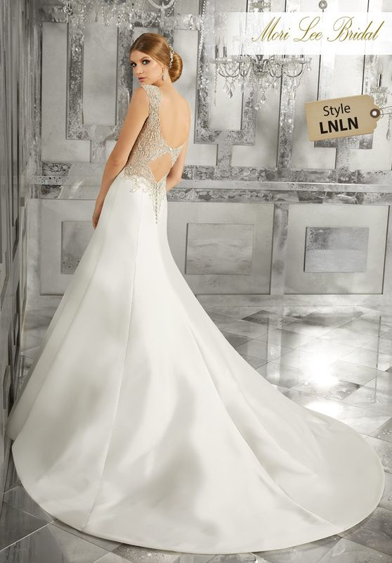 Style LNLN Meranda Wedding Dress  This Sleek A -Line Marcella Satin Wedding Dress Features Intricate Crystal Beaded, Embroidred Straps and Heyhole Back Detail. Colors Available: White/Silver, Ivory/Silver.