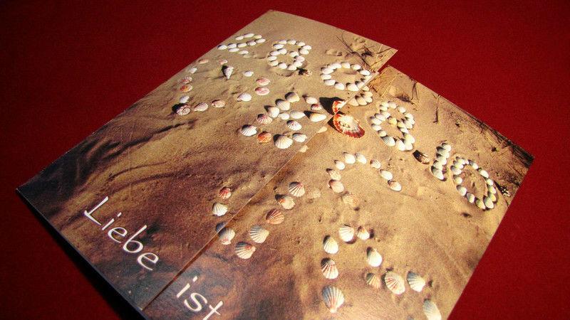 Beispiel: Ihr Partner in Drucksachen, Foto: Die Drucker Hochzeitskarten.