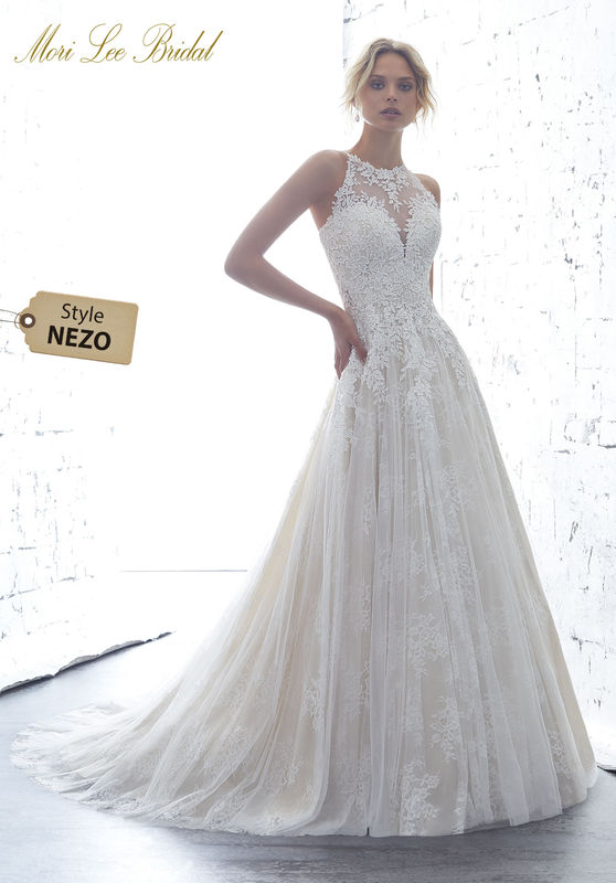 Style NEZO Kayleigh Wedding Dress  Guipure Lace Appliqués Accent the High Halter Bodice on This Soft English Net Over Chantilly Lace Ballgown. A Sheer Racer Back Trimmed in Covered Buttons Completes the Look. Colors Available: White, Ivory, Ivory/Crème