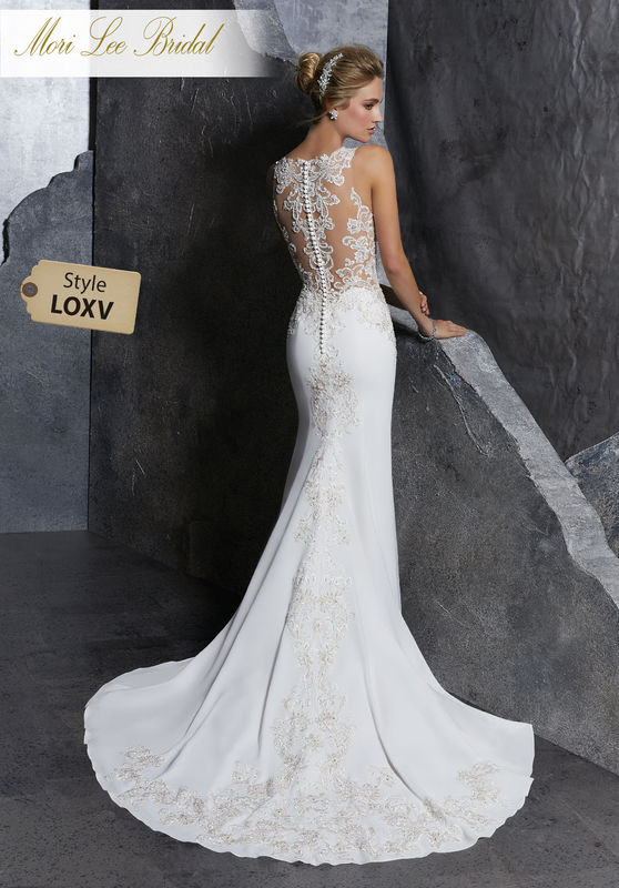 Style LOXV  Koko Wedding Dress  Crystal Beaded and Embroidered Appliqués Accent the Sheer Bodice on this Net and Stretch Crepe Sheath. A Beautifully Beaded Illusion Back Trimmed in Covered Buttons Completes the Look. Matching Satin Bodice Lining Included. Colors Available: Ivory