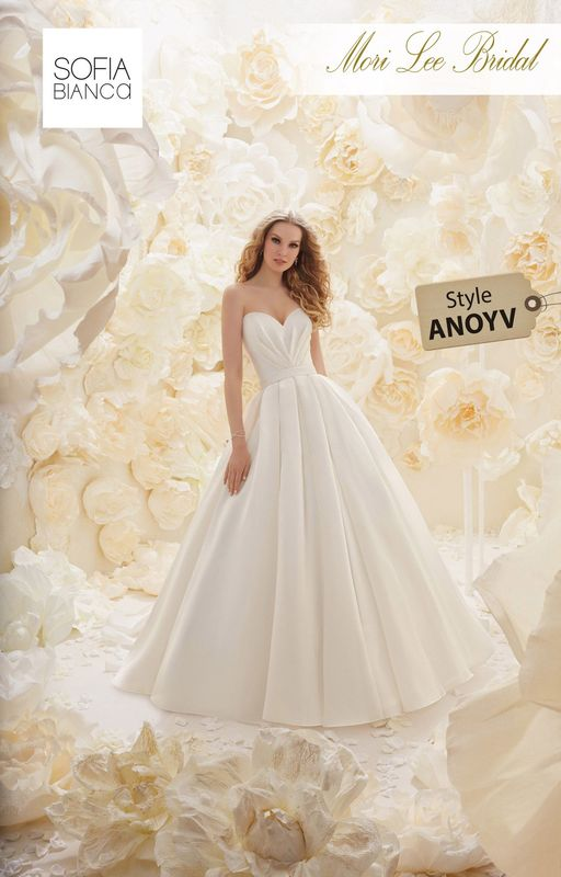 Style ANOYV A TEXTURED ORGANZA GOWN WITH A RUCHED STRAPLESS BODICE AND OVERSIZED PLEATED SKIRT WITH A REMOVABLE OFF THE SHOULDER BUTTON BACK LACE JACKET  COLOURS IVORY