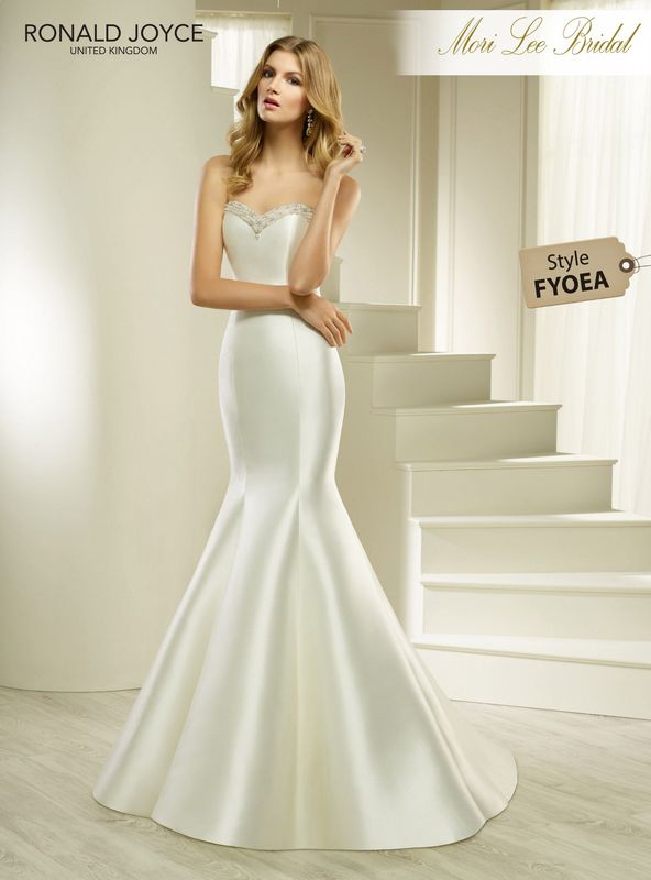 Style FYOEA HEVA  AN ELEGANT STRAPLESS MIKADO FISHTAIL DRESS WITH A BEADED SWEETHEART NECKLINE AND BACK BUTTON DETAIL. PICTURED IN IVORY.  COLOURS WHITE, IVORY