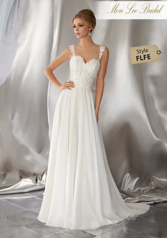 Style FLFE Meera Wedding Dress  Perfect for a Desintation Wedding, This Silky Chiffon Wedding Dress Features a Crystal Beaded and Embroidered Bodice with Criss-Cross Appliquéd Straps. Colors Available: White, Ivory, Ivory/Light Gold.