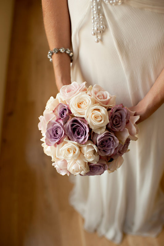 Bridal bouquet. Full, round bouquet of mixed pink, lavender and champagne coloured roses