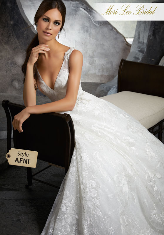 Style AFNI Kalista Wedding Dress  Romatic A-Line Bridal Gown Featuring Frosted Beading on Floral Embroidered Chantilly Lace. Three-Dimensional Floral Trim Accents the Shoulder Straps and Waistline. Colors Available: White, Ivory