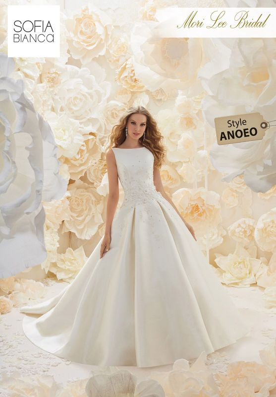 Style ANOEO A LARISSA SATIN A-LINE DRESS WITH BATEAUX NECKLINE, OPEN BACK DETAIL, OVERSIZED PLEATS AND A UNIQUE BEADED FLORAL EMBROIDERY  AVAILABLE IN 3 LENGTHS: 55', 58' AND 61'     COLOURS WHITE OR IVORY