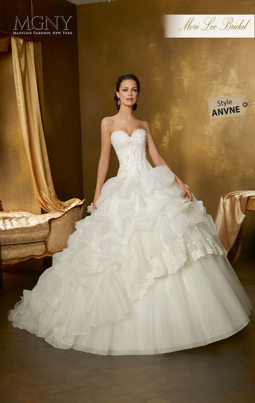 Style ANVNE Ourania  Crystal beaded, embroidered appliqués on chantilly lace, boned corset bodice with a ruched organza ball gown skirt with lace and tulle tiers