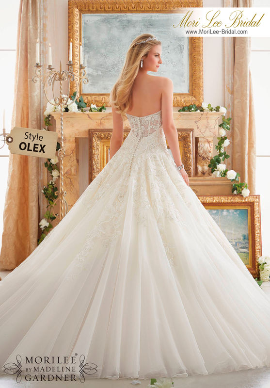 Dress Style OLEX ROSE PATTERNED EMBROIDERY WITH CRYSTAL BEADING ON TULLE BALL GOWN  Colors Available: White/Silver, Ivory/Silver, Light Gold/Silver