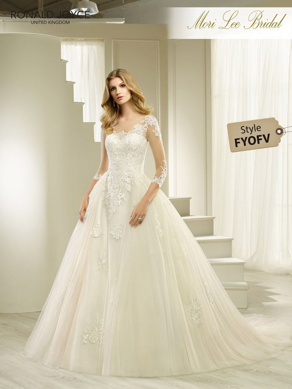 Style FYOFV HOSANA A TULLE AND SATIN BALLGOWN WITH LACE APPLIQUES AND ILLUSION TULLE ¾ LENGTH SLEEVES. PICTURED IN IVORY.  COLOURS WHITE, IVORY, IVORY/SAND