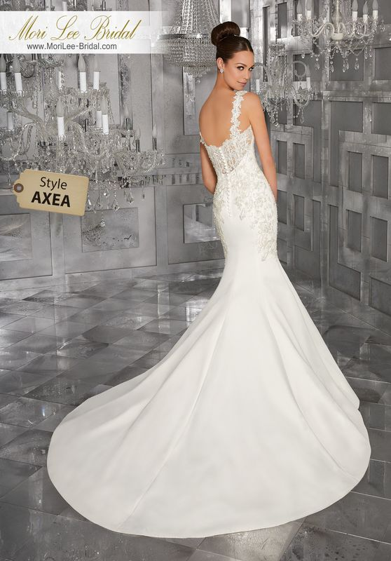 Style AXEA Maris Wedding Dress  Crystal Beaded, Embroidered Appliqués Take this Chic Peau de Soie Wedding Dress to the Next Level. Removable Lace Appliquéd Shoulder Straps, Also Sold Separately as Style#11277, Complete the Look. Shown with Detachable Tulle Train (not included), Sold Separately as Style NXOEI. Colors Available: Ivory.