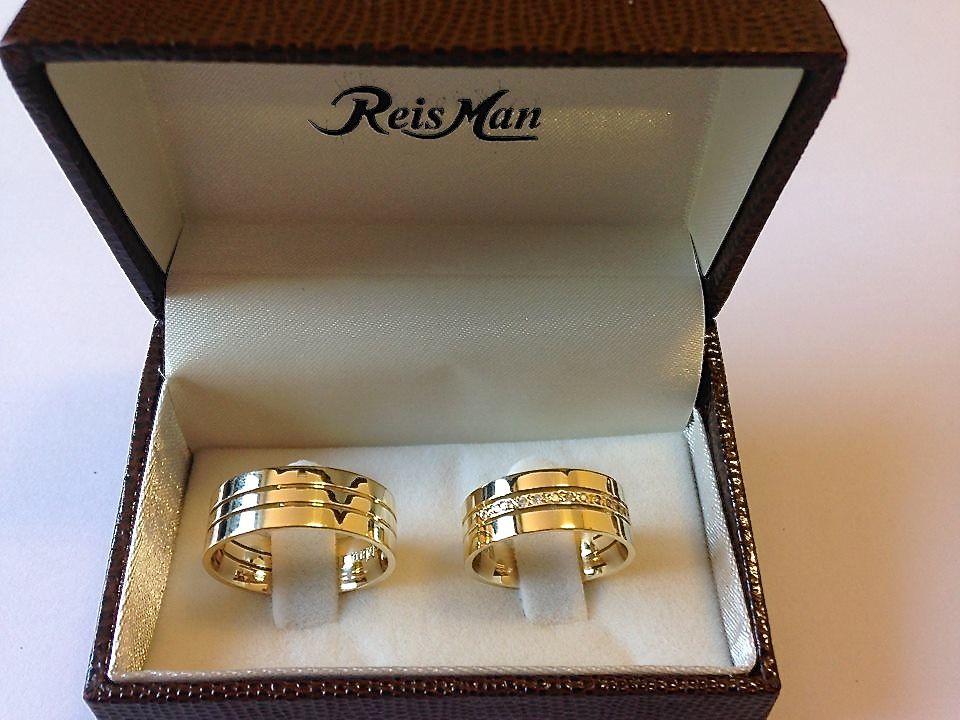 Reisman Alianças e Jóias - Par de Alianças Trieto Diamantes Centrais REF: 8054